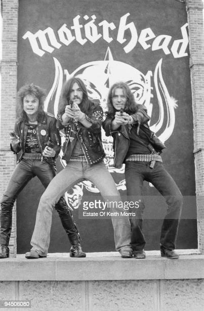 British heavy rock band Motorhead pose with pistols in front of a banner London 1978 Left to right drummer Phil 'Philthy Animal' Taylor bassist and...