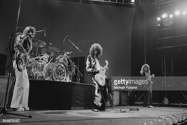 British heavy rock group Led Zeppelin performing at Earl's Court London May 1975 Left to right John Paul Jones John Bonham Jimmy Page and Robert...