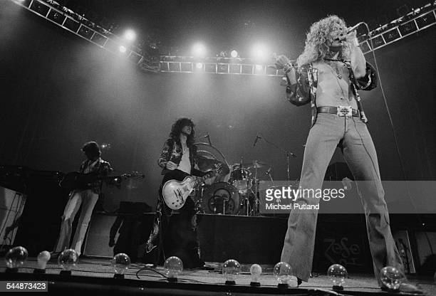 British heavy rock group Led Zeppelin performing at Earl's Court London May 1975 Left to right John Paul Jones Jimmy Page John Bonham and Robert...