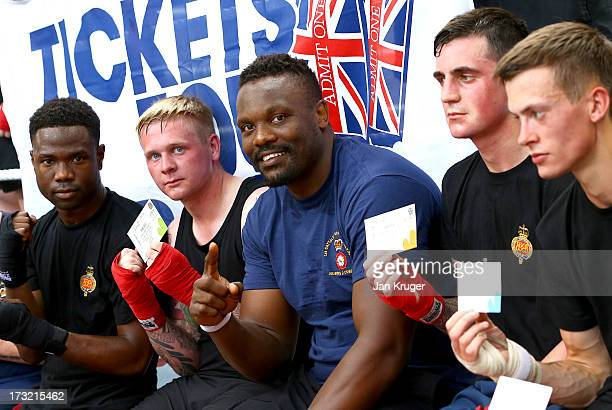 British heavyweight boxer Dereck Chisora poses with Army boxers from the Grenadier Guards during a media workout as he prepares for his showdown with...