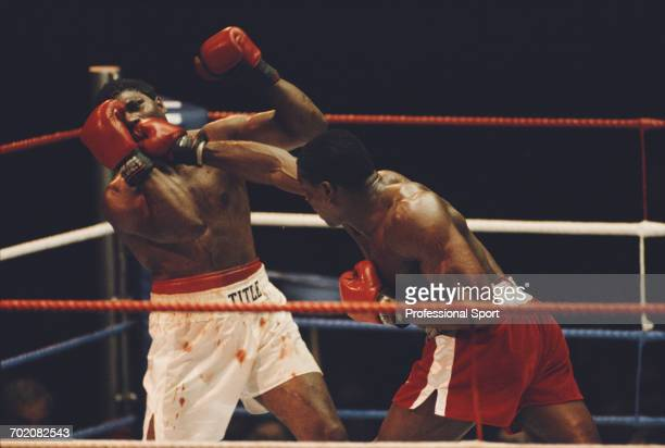 British heavyweight boxer Frank Bruno lands a punch to the jaw of American boxer James Tillis during their heavyweight fight at Wembley Arena in...