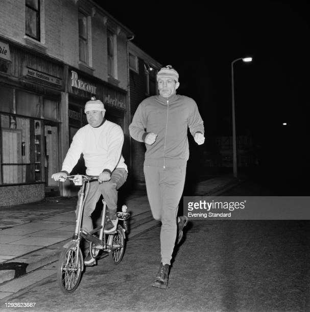 British heavyweight boxer Henry Cooper training for his upcoming fight with Cassius Clay , with the help of trainer and cornerman Danny Holland , UK,...