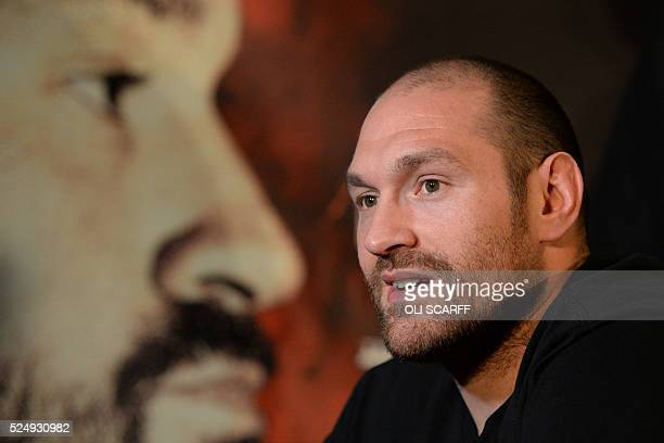 British heavyweight boxer Tyson Fury speaks during a press conference to publicise his forthcoming world heavyweight title fight against Ukranian...