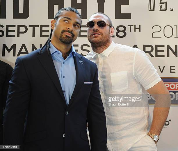 British heavyweight boxers David Haye and Tyson Fury attend a press conference to announce their upcoming title fight on July 11 2013 in London...