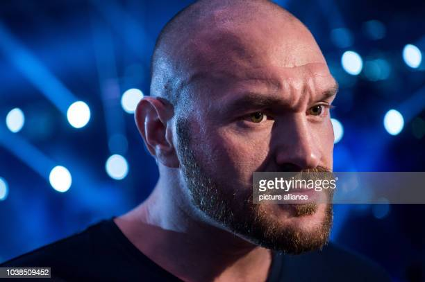 British heavyweight boxing World Champion Tyson Fury speaks during an interview as he attends the European Heavyweight Championship boxing match...