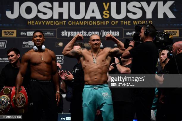 British heavyweight champion boxer Anthony Joshua and Ukraine's Oleksandr Usyk take part in a weigh-in at the O2 arena in advance of their bout in...