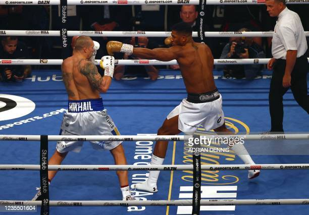 British heavyweight champion boxer Anthony Joshua and Ukrainian boxer Oleksandr Usyk exchange punches during their heavyweight boxing match at...