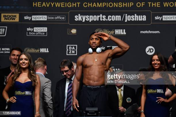 British heavyweight champion boxer Anthony Joshua gestures during his weigh-in at the O2 arena ahead of his bout with Ukraine's Oleksandr Usyk, in...