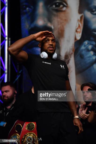 British heavyweight champion boxer Anthony Joshua gestures on arival for his weigh-in at the O2 arena ahead of his bout with Ukraine's Oleksandr...