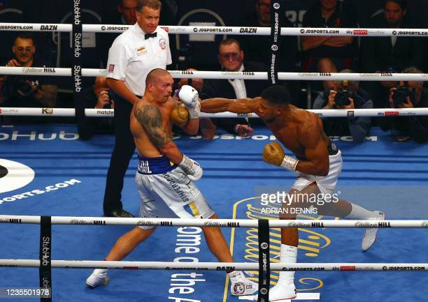 British heavyweight champion boxer Anthony Joshua throws a punch against Ukrainian boxer Oleksandr Usyk during their heavyweight boxing match at...