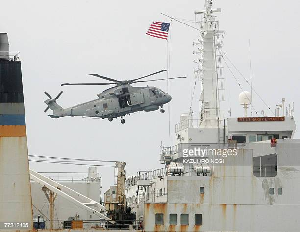 A British helicopter flys over the target ship the US transport ship 1st Lt Harry Martin during exercises which are part of three days of drills...