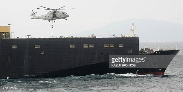 A British helicopter unloads a naval personnel on to a target ship the US transport ship 1st Lt Harry Martin during exercises which are part of three...