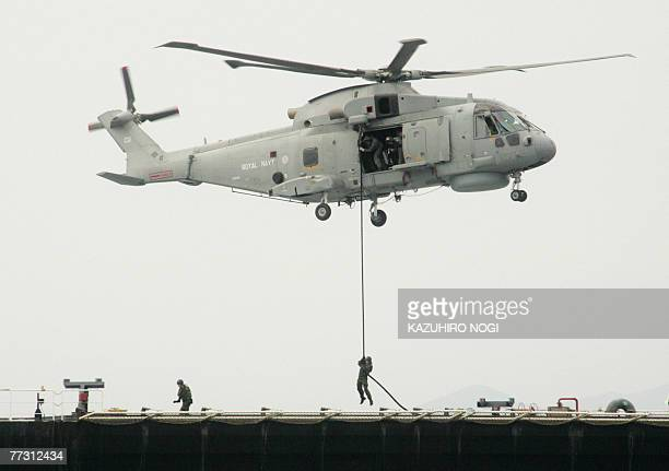 A British helicopter unloads naval personnel as they catch up with the target ship the US transport ship 1st Lt Harry Martin during exercise which...