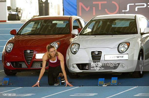 British heptathlon specialist Louise Wood practises in the blocks as she poses for photographers during the launch of the new Alfa Romeo MiTo Sprint...