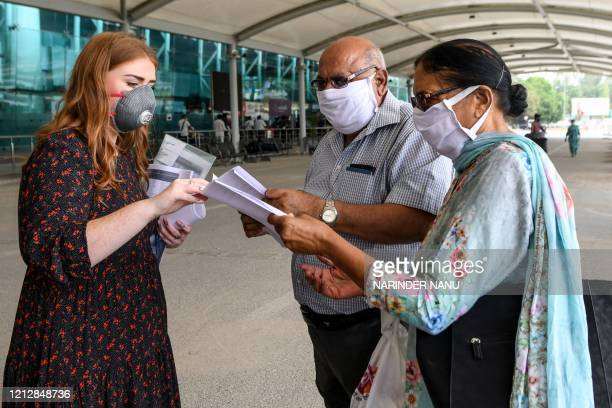 A British High Commission official checks documents of British nationals queueing before checkingin for a special flight to London after the...