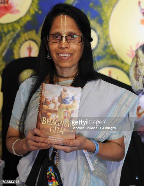 British Hindu Mina Josh poses for the camera with a copy of the Bhagavad Gita during the Village India Experience Gujarat held at De Montfort Hall in...