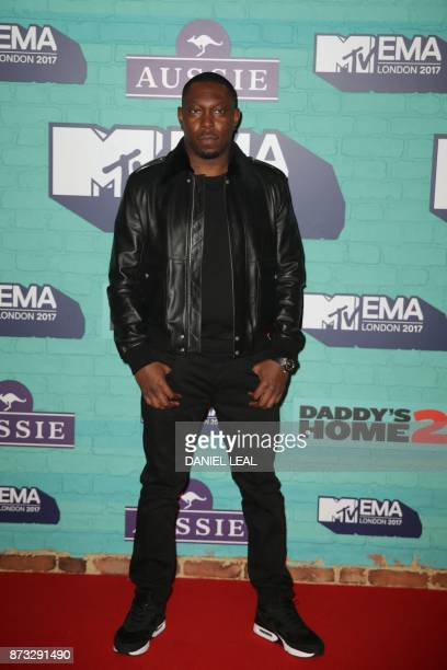 British hiphop artist Dizzee Rascal poses on the red carpet arriving to attend the 2017 MTV Europe Music Awards at Wembley Arena in London on...