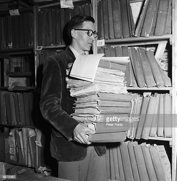 British historian Kenneth Duke with documents detailling the foreign policy of the Third Reich up to and during World War II captured by US First...