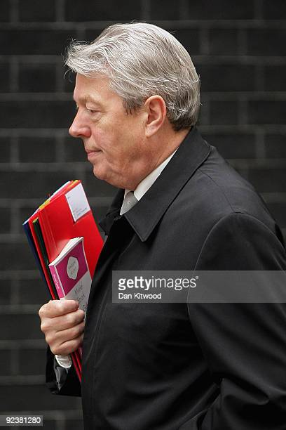 British Home Secretary Alan Johnson carries Muriel Spark's 'The Girls of Slender Means' into the weekly cabinet meeting on October 27 2009 in London...