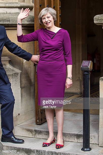 British Home Secretary and Conservative leadership contender Theresa May waves outside the Houses of Parliament on July 7 2016 in London England...