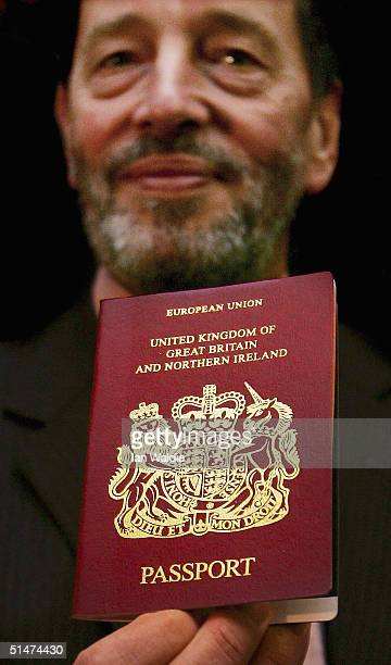 British Home Secretary David Blunkett holds up a passport during an event to launch free passports for the wartime generation, on October 13, 2004 in...