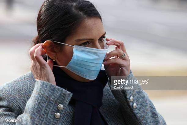 British Home Secretary Priti Patel adjusts her face mask outside St Thomas' Hospital on January 18, 2021 in London, England. Last week, Ms Patel said...