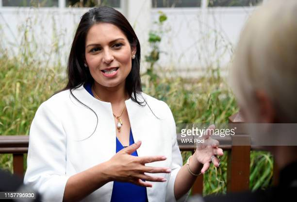 British Home Secretary Priti Patel gestures as she speaks during a visit to the West Midlands Police Learning & Development Centre on July 26, 2019...