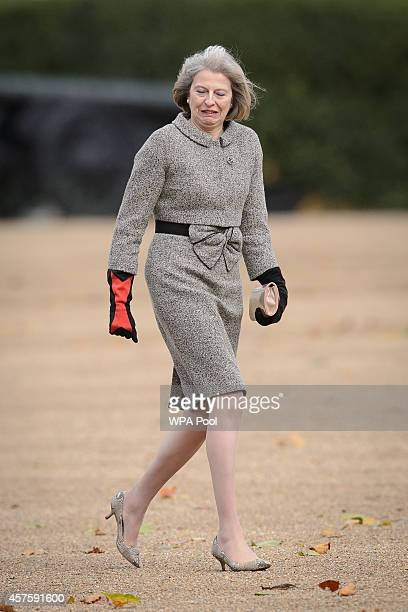 British Home Secretary Theresa May arrives to attend the ceremonial welcome ceremony for Singapore's President Tony Tan Keng Yam at the start of a...