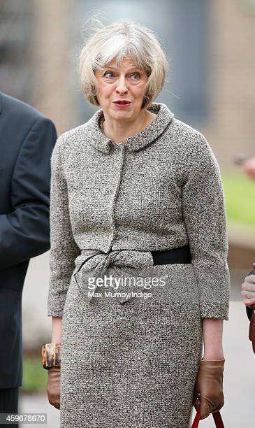 British Home Secretary Theresa May awaits the arrival Queen Elizabeth II for a visit to Holyport College on November 28 2014 in Holyport England