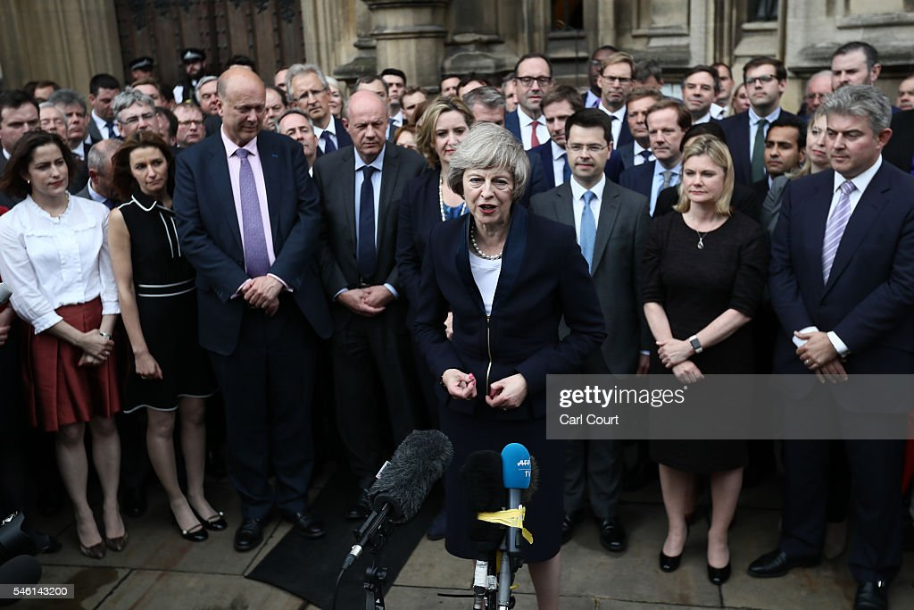 British Home Secretary Theresa May makes a statement surrounded by members of the Tory party after Andrea Leadsom pulled out of the contest earlier today to become Conservative Party leader outside the Houses of Parliament on July 11, 2016 in London, England. Theresa May will become the UK's new Prime Minister on Wednesday evening after David Cameron holds his final PMQs and visits the Queen to officially resign his position.