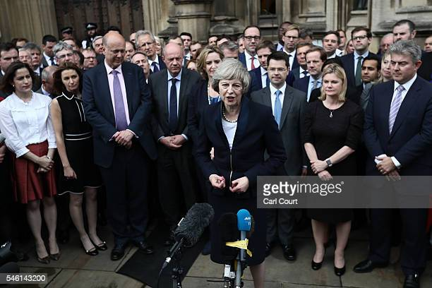 British Home Secretary Theresa May makes a statement surrounded by members of the Tory party after Andrea Leadsom pulled out of the contest earlier...