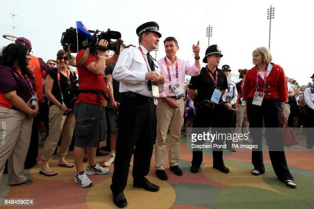 British Home Secretary Theresa May meets Assistant Metropolitan Police Commissioner Chris Allison LOCOG Chairman Lord Sebastian Coe and PC Asa Warren...