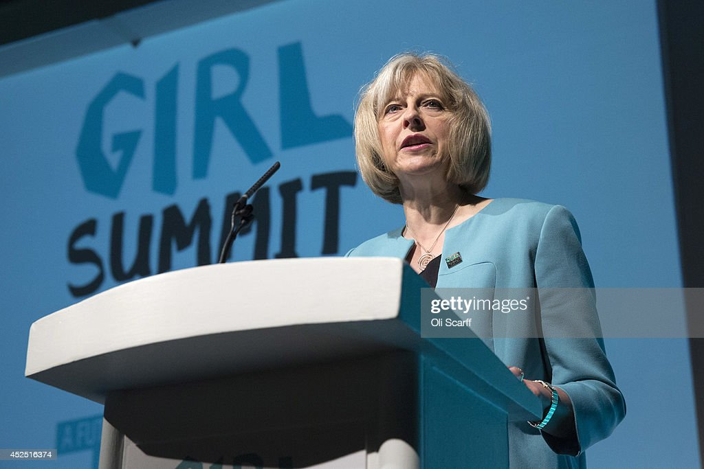 British Home Secretary Theresa May speaks at the 'Girl Summit 2014' in Walworth Academy on July 22, 2014 in London, England. At the one-day summit the government has announced that parents will face prosecution if they fail to prevent their daughters suffering female genital mutilation (FGM).