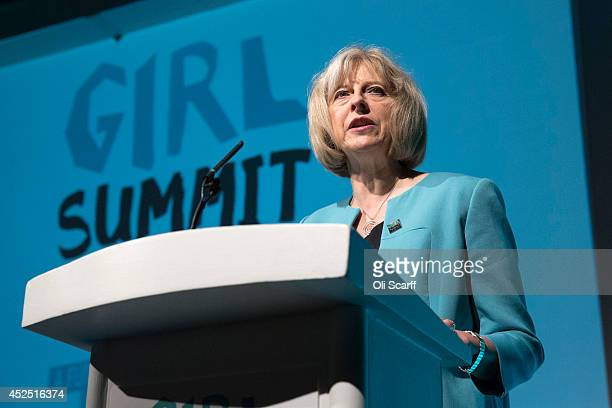 British Home Secretary Theresa May speaks at the 'Girl Summit 2014' in Walworth Academy on July 22 2014 in London England At the oneday summit the...