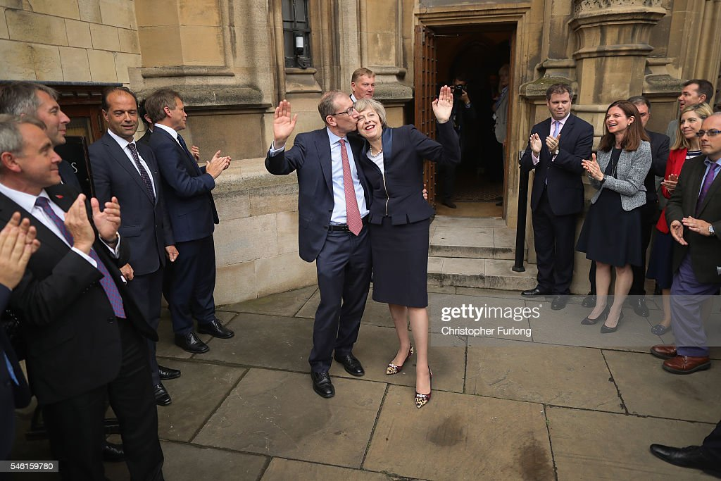 British Home Secretary Theresa May waves as she stands with her husband Philip John May before she makes a statement after Andrea Leadsom pulled out of the contest earlier today to become Conservative Party leader outside the Houses of Parliament on July 11, 2016 in London, England. Theresa May will become the UK's new Prime Minister on Wednesday evening after David Cameron holds his final PMQs and visits the Queen to officially resign his position.