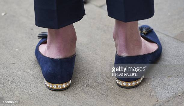 British Home Secretary Theresa May's shoes are pictured as she addresses media personnel outside the Cabinet Office in London on June 28 following a...