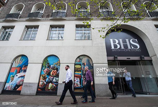 British Home Stores employees leave the BHS headquarters where staff were told this morning that the company will go into administration on April 25...
