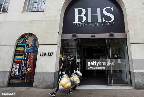 British Home Stores employees take bags out of the BHS headquarters on Marylebone Road on April 25 2016 in London England High street retailer...