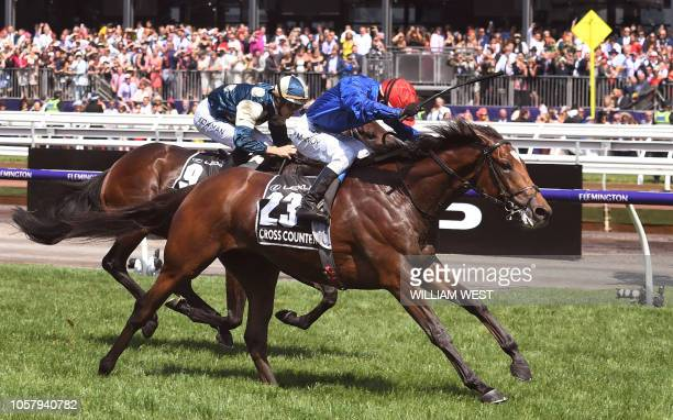 British horse Cross Counter ridden by jockey Kerrin McEvoy wins the Melbourne Cup ahead of fellow British horse Marmelo in Melbourne on November 6,...