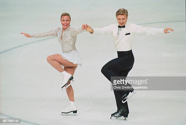 British ice dancers and figure skaters Jayne Torvill and Christopher Dean pictured performing together on ice during competition at the British Ice...