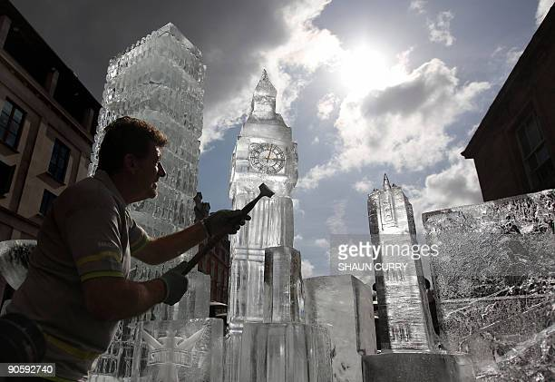 British ice sculptor Duncan Hamilton carves out ice from his sculpture of London's iconic Big Ben in Covent Garden in central London on September 11...