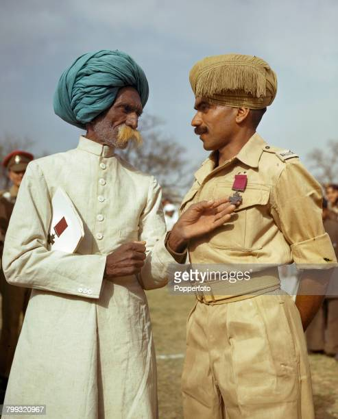 British Indian Army soldier Bhandari Ram Sepoy in the 16th Battalion 10th Baluch Regiment pictured with his father after he was awarded the Victoria...