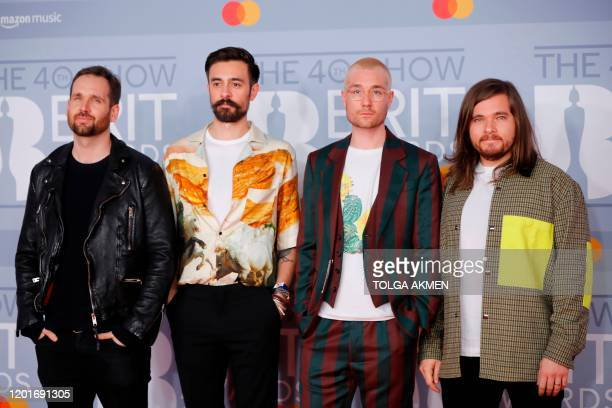 British indie pop band 'Bastille' Dan Smith Kyle Simmons Will Farquarson and drummer Chris Wood pose on the red carpet on arrival for the BRIT Awards...