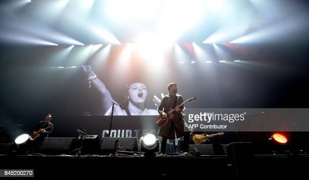 British indie rock band Courtenners perform during the 'We Are Manchester' charity concert at the Manchester Arena in Manchester northwest England on...