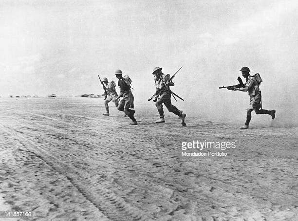 British Infantry squad following the retreating German forces. El Alamein, November 1942