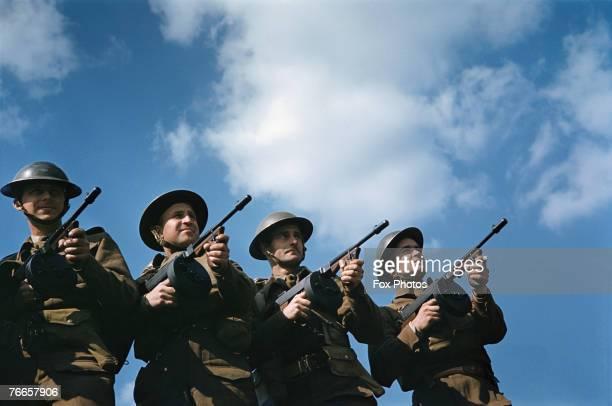 British infantrymen training with Thompson submachine guns, circa 1940.