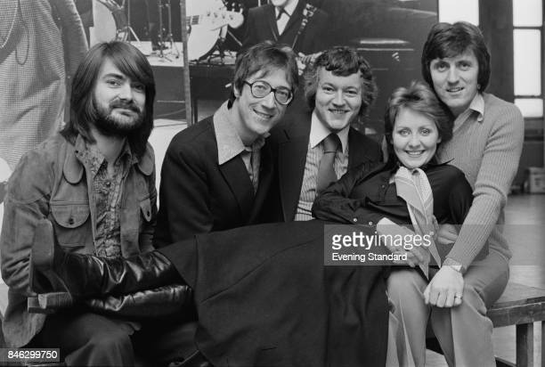 British instrumental rock group The Shadows with Scottish singersongwriter Lulu 3rd January 1975 From left to right John Farrar Hank Marvin Brian...