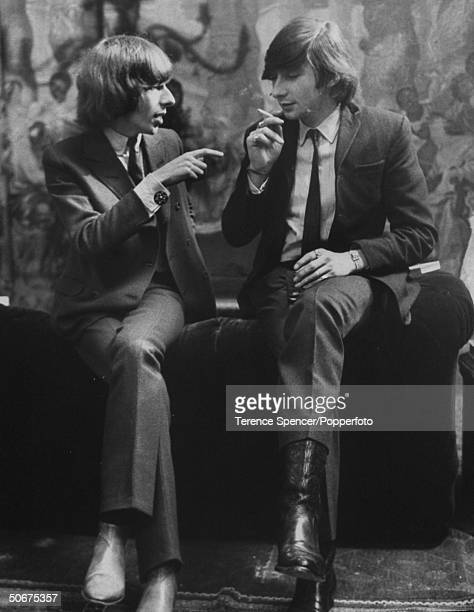 David Mlinaric and Julian OrmsbyGorge are engaging in an conversation while attending a party at Chrisopher Gibbs' place