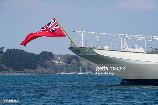 """British inventor and businessman Sir James Dyson's classic luxury motor yacht """"Nahlin"""" flies the Red Ensign while moored off the Cornish Coast on..."""