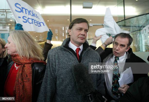 British investigative reporter Brian Deer confronts British Doctor Andrew Wakefield as he arrives with his wife Carmel at the General Medical Council...